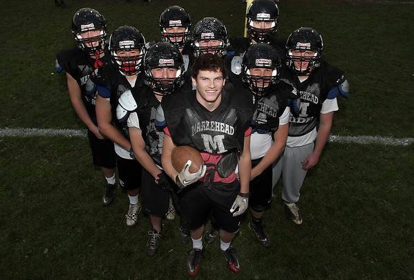 Marblehead senior runningback Will Quigley, center, recently broke Marblehead's all-time scoring record with 228 points. He is surrounded by his offensive linemen who have contributed to his success this season for the Magicians. David Le/Salem News