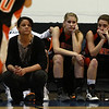Ipswich head coach Mandy Zegarowski, left, freshman Caroline Soucy, center, and senior Nyra Constant, right, can only watch as time winds down in the D3 North Final against Pentucket on Saturday morning. The Tigers lost to the Sachems 49-30.  David Le/Staff Photo