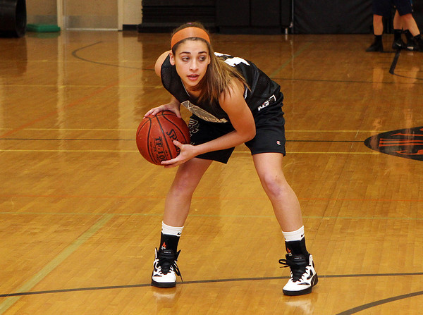Ipswich captain Nyra Constant looks for a teammate to pass to during practice on Thursday. David Le/Salem News