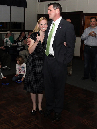 Peabody Mayoral candidate Sean Fitzgerald puts his arm around his wife Jenni, who gives a thumbs up, even after learning they lost the race to Ted Bettencourt. David Le/Staff Photo