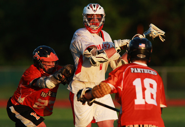 Masco senior Kurt Hunziker, center, looks to pass while being pursued by Beverly's Dan Brown, left, and Cam Jones, right, during the North Shore Cup on Wednesday afternoon. David Le/Staff Photo