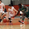 Beverly: Beverly's Dan Cacciatore (31) left, Lynn Classical's Moise Builou (11) battle for a loose ball on Tuesday night. David Le/Salem News