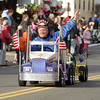 A member of the Shriners waves as he drives a mini truck down Cabot St. as a part of the annual Beverly Holiday Parade on Sunday afternoon. David Le/Salem News