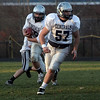 Hamilton-Wenham running back Elliott Burr left, looks for running room as teammate Shane Jenkins (57) gets out front for a block during practice. David Le/Salem News