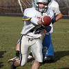 Hamilton-Wenham quarterback Trevor Lyons hands the ball off during practice on Sunday mornig. David Le/Salem News
