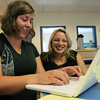 "Teegan von Burn, right, Assistant Principal at the Carlton School in Salem, helps Erin White, P1 Teacher learn a new technology program as part of the adoption of a ""innovation school"" model for the upcoming school year.  David Le/Staff Photo"