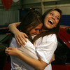 Peabody High School senior Linda Pratto, left, gets a hug from friend and classmate Vicki Arons, after she won a car from Hyundai Village as part of the Keys To Success program on Friday afternoon. David Le/Staff Photo