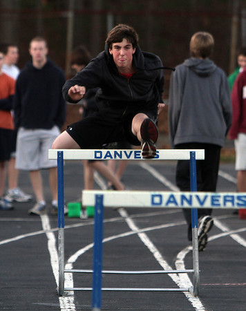 Danvers High School junior Nick Caldarone practices the high hurdles on Thurday. David Le/Salem News