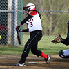 Salem High School freshman Mikayla Dion makes contact against Beverly on Tuesday afternoon. David Le/Staff Photo