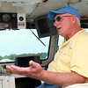 Captain Jay Michaud, of Marblehead, talks about the lobster industry aboard his boat _________ on Friday afternoon. David Le/Staff Photo