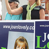 State Senate candidate Joan Lovely waves to passersby in Danvers Square with her supporters on Saturday morning. David Le/Staff Photo