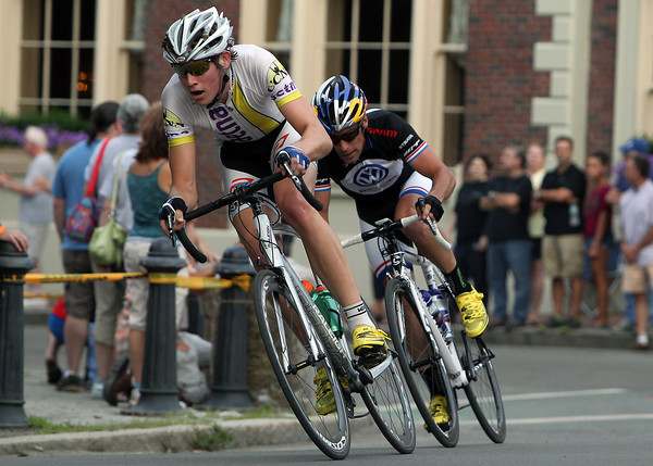 Men's Elite riders Ben Wolfe, left, and Tim Johnson, right, fly around a corner near the Hawthorne Hotel during the Witches' Cup race on Wednesday evening. David Le/Staff Photo