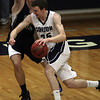 Gordon's David Dempsey (25) drives to the hoop against Endicott's Matt Kneece (32) on Wednesday night. David Le/Salem News
