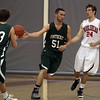 Pentucket's Will Angelini (51) hands the ball off to teammate Calvin Wiles (23). David Le/Staff Photo
