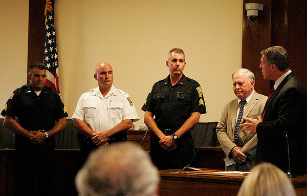 Beverly: From left, Beverly Police Officers Sgt. Richard Russo, Lt. Joseph Shairs, and Sgt. David Faustino are congratulated on their promotions by Beverly Police Chief Mark Gray, right, and Mayor of Beverly, Bill Scanlon, in a ceremony Tuesday evening held at Beverly City Hall. Photo by David Le/Salem News
