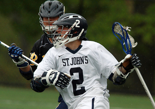 St. John's Prep attackman Jack Sharrio protects the ball while being pressured by an Xaverian defender on Tuesday afternoon. David Le/Staff Photo