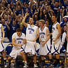 The Danvers Falcons bench explodes after senior George Merry dunks the ball putting an emphatic stamp on the Falcons' victory over the Crusaders of St. Joseph's during the D3 State Championship at the DCU Center in Worcester. David Le/Staff Photo
