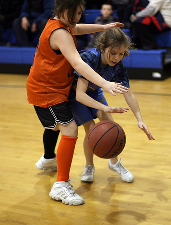 Brown School's Shannon O'Connell, right, dribbles towards the hoop against a Center School player on Friday afternoon. David Le/Salem News
