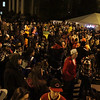 A very large crowd of people gathered around the stage in front of the courthouse to listen to live music on Halloween night. David Le/Staff Photo.