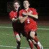 Masco senior captain Chad Burke (2) celebrates his second goal of the game against Greater New Bedford with teammate Stephen Pease (22) left. Burke scored two goals to led the Chieftans to a 2-0 victory on Tuesday night in Weymouth. David Le/Salem News