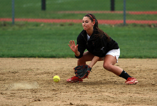 Masco senior captain and shortstop Taylor Evans fields a grounder at practice on Thursday. David Le/Staff Photo