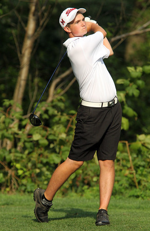 Marblehead junior Pitch Riley tees off against Beverly on Friday afternoon. David Le/Staff Photo