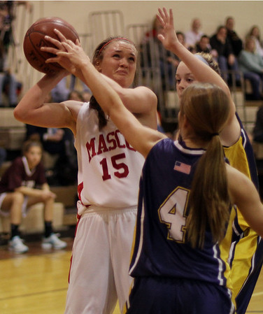 Topsfield: Masco's Danielle Davis (15) winces as she is fouled by two Arlington Catholic defenders. David Le/Salem News