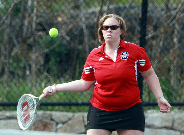Salem senior captain Megan Marshall returns a volley during second singles play on Monday against Marblehead. David Le/Staff Photo