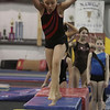 Yellowjackets gymnast Katie Dumont prepares to do a flip. David Le/Staff Photo.