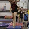 Yellowjackets gymnast Katie Dumont prepares to do a flip. David Le/Staff Photo.
