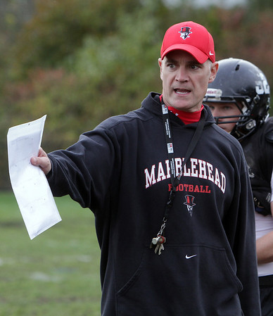 Marblehead High School coach Jim Rudloff instructs some of his players at practice on Thursday afternoon. David Le/Salem News
