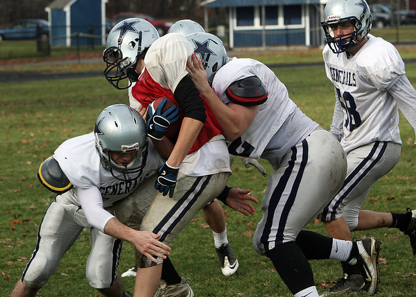 Hamilton-Wenham players collide for a tackle during practice on Sunday morning. David Le/Salem News