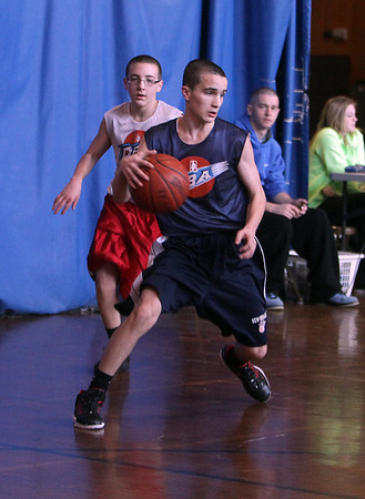 BIlly Trachia crosses over an opponent during a PBA basketball game on Saturday morning. David Le/Salem News