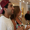 Ipswich: Rafee Talukder and Meredith Martelli of Boston, look at a few of the paintings on display at the silent art auction held at Wavepaint Design and Gallery in Ipswich. The benefits from the auction will go to Partners in Development and their work in Haiti. Photo by David Le/Salem News