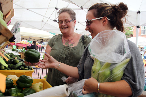 Tracey Mitchell, left, and Amanda Molina, both of Salem, look through some produce at the Salem Farmer's Market on Thursday afternoon. David Le/Staff Photo
