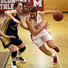 Topsfield: Masco's Brooke Stewart drives to the hoop against Arlington Catholic on Thursday night. David Le/Salem News