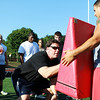 Danvers: Former Superbowl Champion Mike Flynn demonstrates blocking techniques to local high school football players at a mini camp held at Bishop Fenwick High School on Tuesday afternoon. Photo by David Le/Salem News