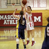 Topsfield: Masco's Brooke Stewart (32) shoots a three-pointer over an Arlington Catholic defender. David Le/Salem News