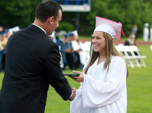 Peabody High School graduate Victoria Arons receives a handshake and her diploma from Peabody Mayor Ted Bettancourt, on Friday evening. David Le/Staff Photo