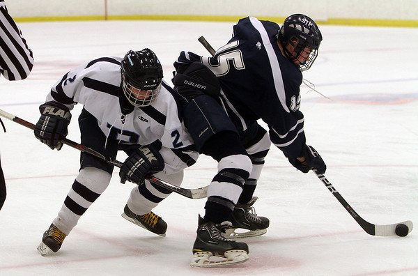 St. John's Prep forward Nick Gianelli (15) controls the puck against Peabody's Andrew Bisconti. David Le/Salem News