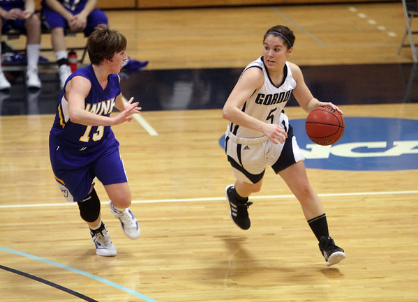 Gordon College point guard Aly Towle (5) looks to drive to the basket against a WNEC player on Wednesday night. David Le/Salem News