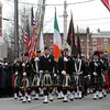 Peabody: Hundreds of bagpipers march down Lowell St. in Peabody, leading the way for Peabody Engine 5, carrying the casket of deceased Peabody firefighter Jim Rice, on Friday morning. David Le/Salem News