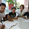 Linda Saris, founder of Salem Cyberspace on Lafayette St. in Salem, works with Salem High School sophomores Juan Martinez, 16, left, Abel Nunez, 16, center, and Jherderson Rosario, 17, right, on Tuesday afternoon. This educational non-profit organization is celebrating its 10th anniversary. David Le/Staff Photo