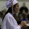 "Danvers: Danvers High School Senior Jenelle McNeill reads her Senior Class Essay: ""To Be Young and Wise"" to her fellow classmates at their commencement ceremonies Saturday afternoon in the Danvers High Gymnasium. Photo by David Le/Salem News"