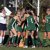 Manchester-Essex field hockey players mob Meghan Jones (holding ball) after she scored in the last minute to put the Hornets' up 3-2 over Swampscott, good enough for a first round victory. David Le/Gloucester Daily Times