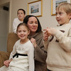 Marblehead: Everest Tilkens, 6, right, talks about his father, Sargeant Paul Atkinson, coming home from duty in Afghanistan, as his twin sister Remington, front center, mother, Maria Tilkens-Atkinson, and step-brother Bailey Atkinson, 11, listen. David Le/Salem News