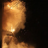 A Beverly firefighter does his best to contain a massive blaze in an apartment complex as he waits for help from other firemen on Wednesday night. David Le/Salem News