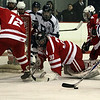 Peabody's Eric Costa (14) right, can't control the puck and shoot it past Saugus goalie Nick Hegarty (30) on Wednesday night. David Le/Salem News