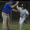 Danvers American centerfielder Jackson Leete gets a high five and pat on the back from Manager Jeff Smith following Leete's 3-run home run off Saugus American reliever Hunter Kreis on Thursday evening. David Le/Staff Photo