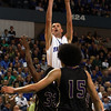 Danvers senior George Merry, center, rises up to hit a jumper over two St. Joseph's defenders during the D3 State Championship game at the DCU Center in Worcester. David Le/Staff Photo